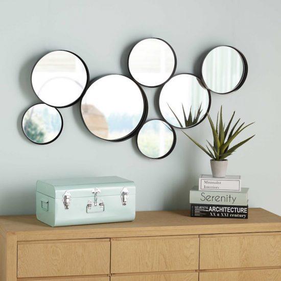 Miroirs ronds en métal noir (121 x 66 cm), Maisons du Monde, 99,90€